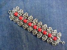 Red bracelet by Julia-EVS.deviantart.com on @DeviantArt