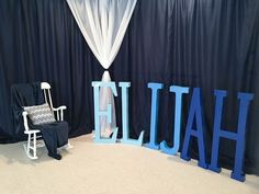Blue Ombre Design. White rocking chair with a navy blue throw for the mom-to-be. The giant letters were purchased at hobby lobby at 70% off making them 14.99 a piece. Spray paint was purchased at Walmart to obtain the ombre affect. Definitely a great prop for any baby shower.