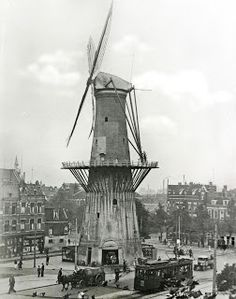 """Molen """"De Noord"""" - het bombardement in 1940 overleefd maar in 1954 door brand verwoest. Windmill in the middle of a city (Oostplein, Rotterdam - Holland), circa Rotterdam, Old Pictures, Old Photos, Throughout The World, Around The Worlds, Netherlands Tourism, Le Moulin, Museum, Delft"""