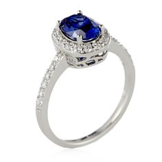 Event Price - 307616 Platinum Plated Diamonique 1.5ct tw Solitaire Halo Ring Sterling Silver  QVC PRICE: £34.50 ONE TIME ONLY PRICE: £28.80 + P&P: £3.95 or 2 Easy Pays of £14.40 +P&P A gorgeous platinum-plated ring solitaire ring from Diamonique with an oval-cut simulated tanzanite stone at the centre, surrounded by round-cut simulated diamonds that also run down each shoulder. This show-stopping ring is perfect for marking a special occasion.