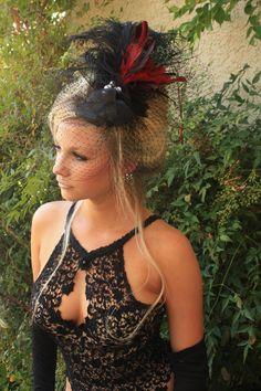 Black VINTAGE Fascinator, Feather Headpiece with BIRDCAGE VEIL from LasVegasVeils. $110.00, via Etsy.