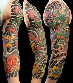 Japanese Tattoo - I like how the dragon and flowers stand out against the black background.