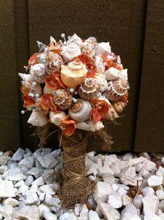 shell + orchid bouquet. great beach wedding idea!