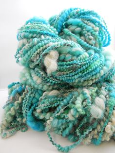 I dyed and blended all these luxurious fibers before spinning them into this kick ass yarn.  It is thick to thin spiral yarn so soft you could make something for a baby's bum.  It has blue faced leciester wool, merino, alpaca, carbonized bamboo, lincoln, sparkle and moxie.  It weighs just over 7 ounces.  It is broken into 2 skiens of yarn one is 74 yards and the other is 72 yards.  $40