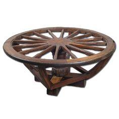 Wagon wheel coffee table-- such a unique piece! Log Cabin Furniture, Western Furniture, Rustic Furniture, Whiskey Barrel Table, Rustic Coffee Tables, Log Table, Teak Table, Wagon Wheel Table, Cabin Coffee