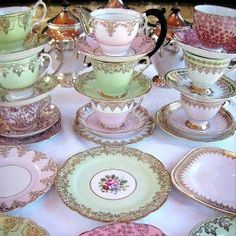 Antique tea-cups & saucers. You chose which one you'd like to use...