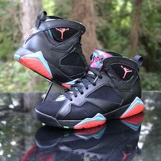 """Paired with the """"Barcelona Days"""" colorway, this version of the Air Jordan 7 is inspired by Michael Jordan's trip to Barcelona for the 1992 Summer Olympics with the Dream Team. The premium black leather upper is highlighted by bright red, teal, and green hues to represent the colors of a beautiful summer night in Barcelona. Jordan Retro 7, Jordan 7, Michael Jordan, Custom Made Jordans, Marvin The Martian, Summer Olympics, Dream Team, Air Jordans, Barcelona"""