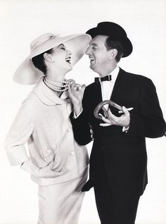 Richard Avedon, Dovima in a Hattie Carnegie suit and hat, with actor Ray Bolger, Harper's Bazaar, 1957