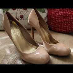 Jessica Simpson Nude Pumps Elegantly Posh Patent Leather Nude Pumps by Jessica Simpson!! Upper part leather, 4-inch stiletto heel, round toe, comfortable, only worn a few times, a classic staple for any wardrobe!! Only one small gray scuff on right shoe, may or may not come off. Jessica Simpson Shoes Heels