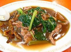Sedap Beef Hor Fun ~ Singapore Beef Hor Fun (Cantonese) thick rice noodles cooked in a thick broth with beef and green vegetables.