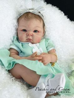 Baby doll in mint.