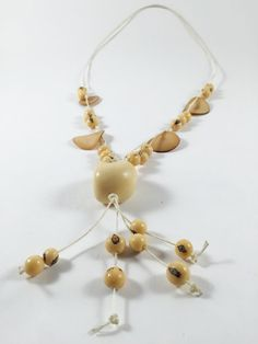 Beige long necklace whole and sliced tagua nut single by MittmibyD