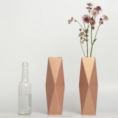 These jewel-like vases from German design duo snug.studio are assembled from flat sheets of cardboard, come as a flat-pack, ready to be folded into shape and placed over a glass or bottle of water.