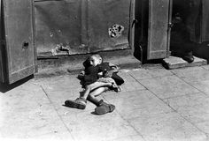 Look at the picture, please. What can you see? - Myself. -- Vs. \\ Warsaw ghetto, summer 1941, Poland, A boy lying in the street, collecting alms. 2 World War, NEVER FORGET, history, photo, black and white, despair, hunger.