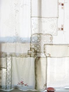 Distinctive linens re-imagined into a larger window dressing or even for a shabby chic outer shower curtain. Here at the thrift store we get cool looking linens that sometimes are spotted. This kind of project would be a great way to recycle them preserving some great examples of lace or needlepoint work along the way.