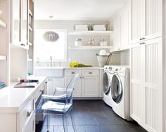 Laundry room office hybrid with light gray subway tile backsplash, white cabinets, clear desk chair | Kriste Michelini Interiors