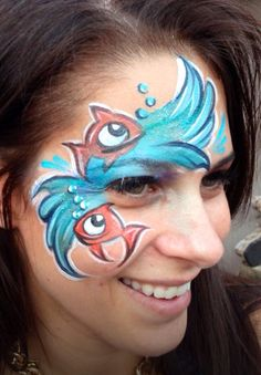 Funny Fish & waves face painting design.