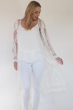This Byron Lace kimono is calling to be worn at all the hottest summer music festivals! This long sleeve, long line kimono made from white lace kimono.  Pair with an tassel necklace & an all white look.