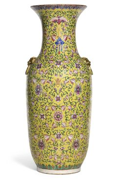 A LARGE CHINESE YELLOW-GROUND FAMILLE-ROSE VASE QING DYNASTY, 19TH CENTURY of ovoid form, set with a pair of gilt animal mask handles, decorated with bats, shou character and precious objects amongst floral scrolls, all reserved on a yellow ground, with a wooden stand