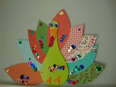Cute bright turkey made with ping pong paddle. This will be right up my daughter's alley. Love the sequins.
