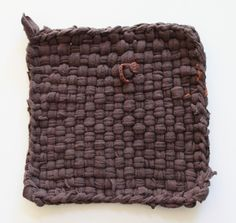 Recycled t-shirtpotholder.  Also a tutorial for piecing the squares together to make a rug.