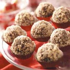 Chocolate Hazelnut Truffles Recipe      3/4 cup confectioners' sugar      2 tablespoons baking cocoa      4 milk chocolate candy bars (1.55 ounces each)      6 tablespoons butter      1/4 cup heavy whipping cream      24 whole hazelnuts      1 cup ground hazelnuts, toasted
