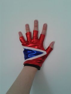 Hand made to order Harley Quinn Suicide Squad inspired cosplay glove. Made with Lycra and elastic.  Please note: When ordering, please send measurments (length x width of hand from base of wrist) and your wrist measurement (circumference). If you are unsure how to get your measurements, please dont hesitate to ask :) Small = wrist 5 inches (circumference) Medium = wrist 7 inches Large = wrist 9 inches  Sizes are a rough guide, please send measurements for an accurate fit x