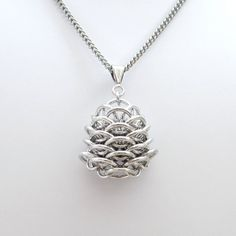 """Chainmaille Dragonscale pendant necklace in """"Dragon's Egg"""" shape by TattooedAndChained, $36.00"""