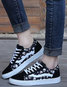 Women's #black leather lace up #sneaker shoe skull pattern print, leather upper and canvas lining.