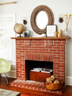 Savvy Storage  Don't let a nonworking fireplace become an unused area. A firebox is a small space that can be used for storage in a stylish way...