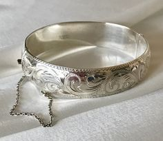 Sterling silver wide hinged bangle bracelet with safety chain Victorian revival style costume jewelry Floral engraved bangle bracelet Silver Bangles, Other Accessories, Costume Jewelry, Bangle Bracelets, Buy And Sell, Winter, Sterling Silver, Chain, Detail