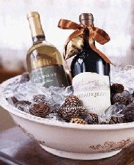 Wine bottles on ice with pine cones in antique ceramic wash basin