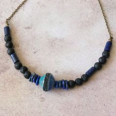 Lapis Lazuli Beaded Necklace, African Style, Blue Black Rustic Raw... ($25) via Polyvore featuring jewelry, necklaces, beaded necklaces, lapis lazuli bead necklace, ceramic bead necklace, lapis lazuli necklace and bohemian necklaces