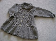 """Debbie Bliss'  """"Smock Jacket"""" knit up by Ishi.  What a great baby gift this would be!"""