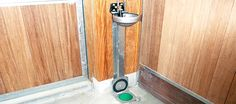 Automatic water feeder above horse manure vacuum disposal unit in floor.  Modern German stables.
