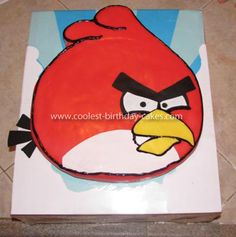 Homemade Red Angry Bird Cake: I baked the chocolate cake as a single layer in a 10 in square pan. Then, using an enlarged image of the red bird, I made a paper cut out of the shape