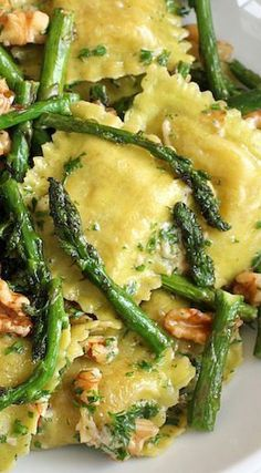 Ravioli with sauteed asparagus and walnuts.
