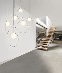 Taking its inspiration from pendant jewelry, the Bola Halo Modern Multi Light Pendant is a uniquely expressive fixture featuring a chromated ring. Modern Lighting, Lighting Design, Modern Chandelier, Chandeliers, Canopy Lights, Ceiling Lights, Multi Light Pendant, Round Pendant, Steel Canopy