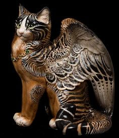 Cuttlefish winged cat. I didn't know such a creature existed. The cat is my familiar, not my totem.
