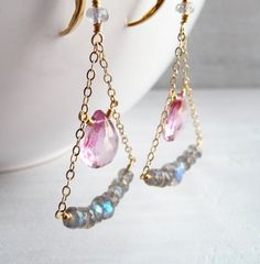 These pretty chandelier hanger earrings feature lovely pink quartz briolette gems and labradorite rondelles. Gems are wrapped in 14k gold filled to gold filled cable chain. Hobo chic deliciousness! ★ Mystic pink quartz measure - 11mm ★ Labradorite rondelles range from 4-6mm  ★ Ear wires - 14k gold filled leverbacks  ★ Earring length - 2.5 See more of my work here: karinagracejewelry.etsy.com    All photos and designs ©2012 Karen Ericson - karina grace jewelry