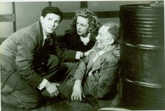 "John Garfield, Geraldine Fitzgerald, and Walter Brennan in ""Nobody Lives Forever"" (1946)"