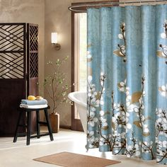 Inspired by the beautiful spring Japanese cherry blossom, the Artology Sakura shower curtain features a white cherry blossom print on a blue ground. Large cherry blossoms cover the curtain in a subtle print.