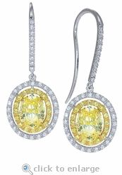 Ziamond Cubic Zirconia Canary Oval & Pave Drop Earrings In 14K Gold.  The Davalos Drops feature a 1.5 carat canary yellow oval cubic zirconia framed by canary yellow pave set rounds and an additional frame of diamond look pave set rounds.  Ziamond features the finest hand cut and hand polished cubic zirconia in gold and platinum settings.  $1495 #ziamond #cubiczirconia #cz #oval #canary #earrings #drops #jewelry #diamond