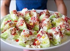 """Healthy Wedge Salads perfect for afternoon tea or luncheon. Ingredients: Chopped Bacon  2 wholeWedge salad sliced in pieces such as the photo above 4 tomatoes """"Roquefort"""" French blue cheese 200 grams 1 red onion Olive oil and balsamic vinegar Preparation: Sliced the salad in 10-12 pieces, then chop the onion, tomatoes and cheese  Add the ingredients above on the salad and cheese, Perfume the dish with enough balsamic vinegar and olive oil."""