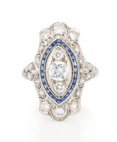 Edwardian Platinum, Diamond and Sapphire Ring   One old European-cut diamond ap. .40 ct., 24 diamonds ap. .70 ct., c. 1915, ap. 3.8 dwt.
