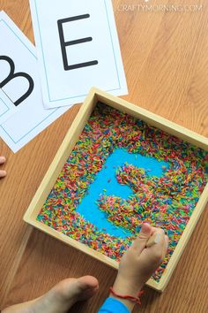Alphabet Writing in Rice Activity - Credits: Crafty Morning