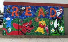 Our 8' X 16' bottle cap mural after the high school students worked a full day with elementary students to [nearly] complete it! (Elementary students using POWER DRILLS!) Will be installed outside our public library this fall. Ridgemont High School Art Department, Ridgeway, Ohio.