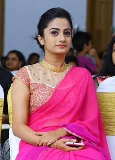 Namitha Pramod in pink saree with high neck blouse