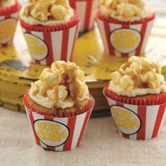 Cupcakes in popcorn cases topped with popcorn and toffee sauce.
