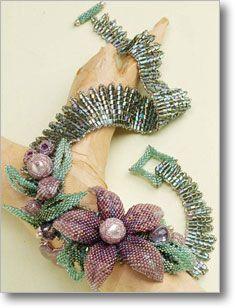 Made in metallic and crystal beads using peyote and herringbone beading designs. Beautiful work. tut at Beading Daily